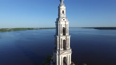 Old steeple sticking out in the middle of the river. Reflection in water. Stock Footage