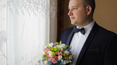 Portrait of young caucasian man with wed bouquet - stock footage