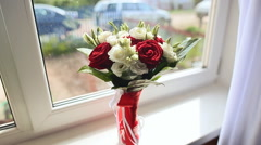 Wedding bouquet on a window sill at home Stock Footage