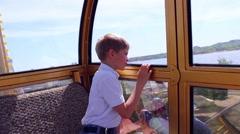 Kid walk on the Ferris wheel ride Stock Footage