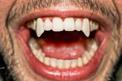 Sharp vampire teeth Stock Photos