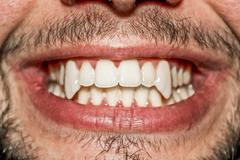 Male vampire mouth Stock Photos