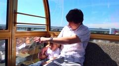 Happy family walk on the Ferris wheel ride Stock Footage