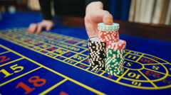 Casino, win at roulette, the payout goes, hands, chips - stock footage