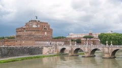 View on famous Saint Angel castle timelapse and bridge over the Tiber river in Stock Footage