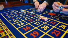 Casino, roulette bets, hands, chips Stock Footage