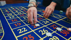 Casino guests are betting on roulette - stock footage