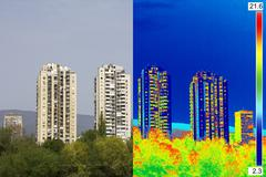 Infrared and real image showing lack of thermal insulation on Residential bui - stock photo