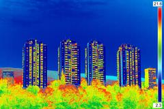 Infrared thermovision image showing lack of thermal insulation on Residential Stock Photos