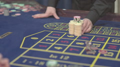 Casino, close-up, the dealer makes the payment of winnings at roulette, S-Log Stock Footage