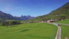 4K Swiss train aerial shot Stock Footage