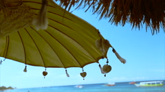 Sunshade umbrella flutter on the wind Stock Footage