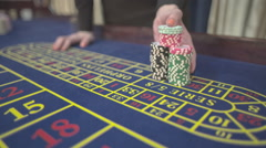 Casino, female hands taking the win on the roulette, S-Log Stock Footage