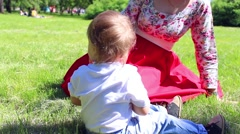 Child in Park drinking water Stock Footage