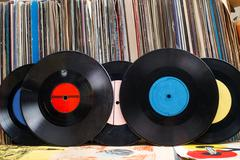 Vinyl record with copy space in front of a collection albums dummy titles Stock Photos