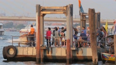 River ferry arriving at floating jetty with tourists,Bangkok,Thailand Stock Footage