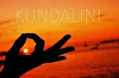 Hands in gyan mudra and text kundalini Stock Photos