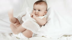 Laughing baby in diapers on a white background, video Stock Footage
