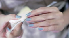 Close-up of young girl's hands crocheting Stock Footage
