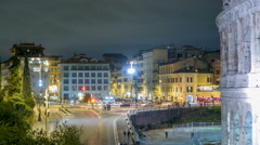 view of square near Colosseum illuminated at night timelapse in Rome, Italy - stock footage
