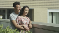 4K Happy romantic couple in new apartment looking at the view from roof terrace. Stock Footage