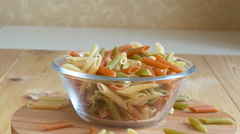 Tri-color pasta in glass bowl rotation - stock footage