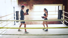 Man woman training gym boxing mma ring pads mixed martial arts fitness Stock Footage