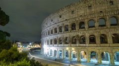 view of Colosseum illuminated at night timelapse hyperlapse in Rome, Italy - stock footage