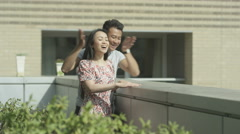 4K Happy couple moving in to new apartment, young man surprises his partner Stock Footage