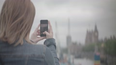 Girl taking picture of Big Ben London Stock Footage