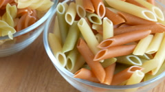 Tri-color pasta close up in rotating - stock footage