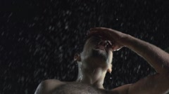 Drunk people outside in the mud and rain - stock footage