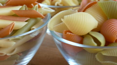 Tri-color pasta close up in rotating. Glass bowl - stock footage