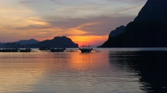 Traditional filippino boats at El Nido bay in sunset lights Stock Footage