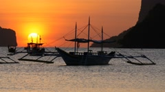 Traditional filippino boats at El Nido bay in sunset lights. Stock Footage