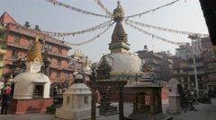 Boys walking around Kathesimbhu stupa,Kathmandu,Nepal Stock Footage