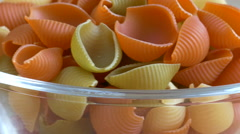 Tri color pasta in glass bowl. Rotating Stock Footage