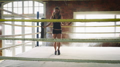 Woman training gym skipping mma ring jump rope mixed martial arts fitness Stock Footage