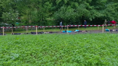 A few teams are crawling over the mud pool very slowly Stock Footage