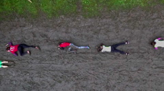 Everyone is slowly moving accross the mud pool Stock Footage