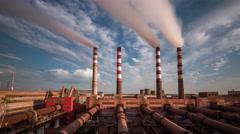 Time lapse. Smoking chimneys. Blue sky. Moving clouds - stock footage