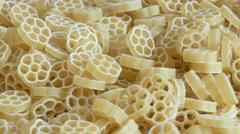 Raw Wagon wheel pasta noodles closeup Stock Footage