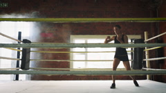 Woman training gym boxing mma ring shadow boxing mixed martial arts fitness Stock Footage