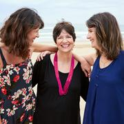 Mother feeling happy and loved by her daughters - stock photo