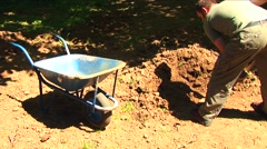 Man digging in his backyard Stock Footage