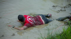 Man is swimming slowly across the mud pool Stock Footage