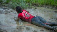 Trying to get across the mud puddles - stock footage