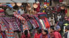Shawl seller in busy shopping street,Kathmandu,Nepal - stock footage