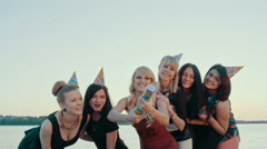 Drunk girls happy at the celebration can not fire crackers. Laughter and emotion - stock footage