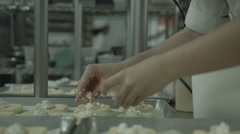 Baking - Adding toppings to pastry Stock Footage